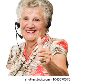 Senior Woman With Headset Showing Thumb-up Sign On White Background