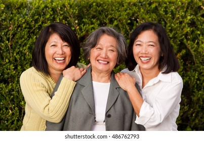 Senior woman with her adult daughters.