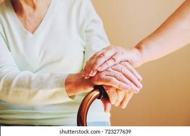 Senior woman with her caregiver at home. Concept senior people health care.