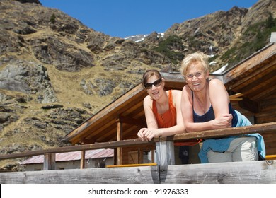 Senior woman and her daughter during a hiking trip in the alps.