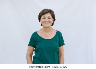 Senior woman with her eyes closed