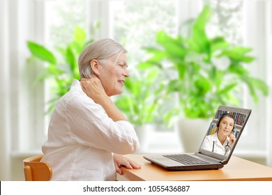 Senior woman in her living room in front of a laptop making a video call with a specialist in orthopedics