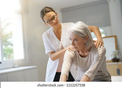 Senior woman with her physiotherapist