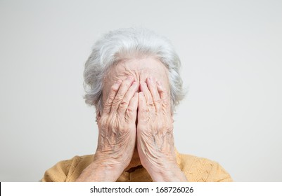 senior woman hiding her face
