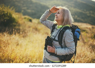 Senior woman is hiking in mountain. Active retirement.