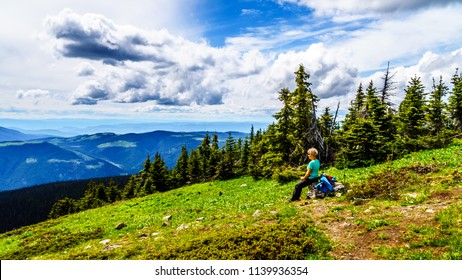 Senior Woman hiking on Tod Mountain near the alpine village of Sun Peaks in the Shuswap Highlands of British Columbia, Canada