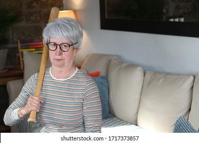 Senior woman holding baseball bat
