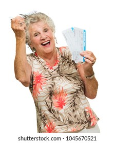 Senior Woman Holding Boarding Pass And Miniature On White Background