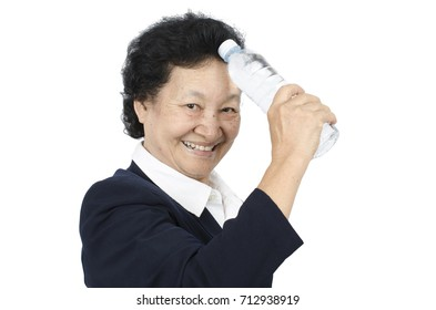 Senior woman holding a bottle water over white background with clipping path