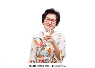 Senior woman holding a glass of milk , isolated on white background.