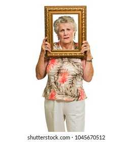 Senior Woman Holding Picture Frame On White Background
