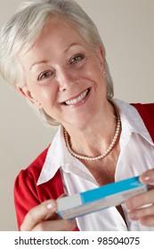 Senior woman holding prescription drug pack