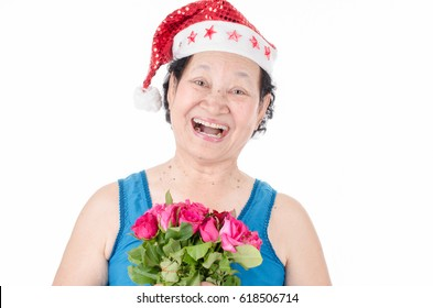 Senior woman holding rose over white background