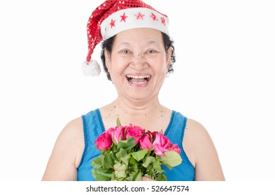 Senior woman holding roses over white background