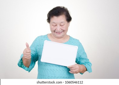 Senior woman holding signboard over white background