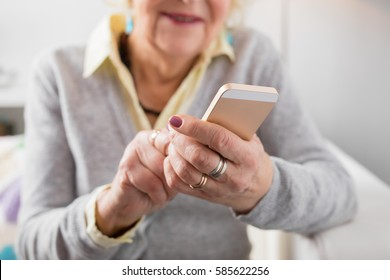 Senior woman holding smartphone