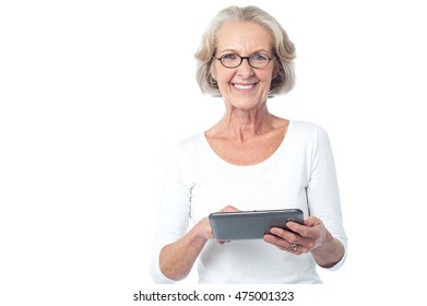 Senior woman holding tablet pc over white.