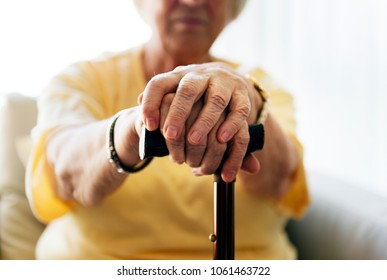 Senior woman holding a walking stick