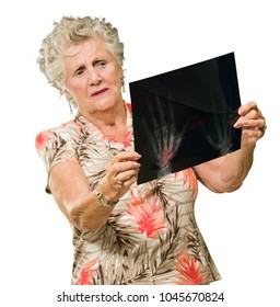 Senior Woman Holding X Ray Report On White Background
