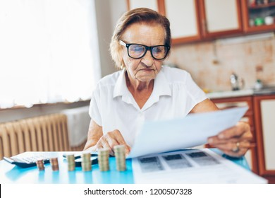 Senior woman at home checking her finances and investments