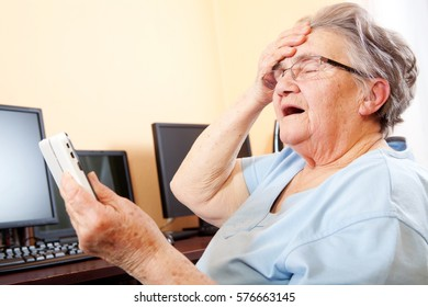 Senior woman at home with digital tablet surfing the net