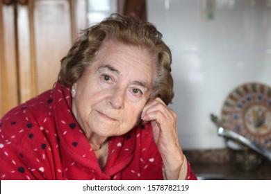 Senior woman at home looking at camera