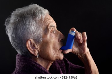 Senior woman with inhaler