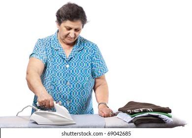Senior woman isolated on white background, ironing clothes