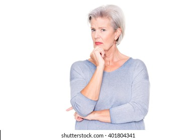 Senior woman ist amazed about something in front of white background