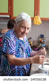 senior woman in kitchen