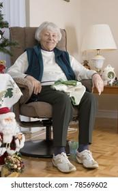 Senior woman knitting vertical