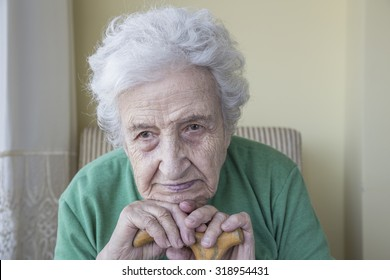 senior woman leaning on cane