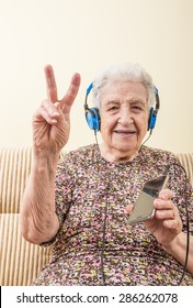 senior woman listening music