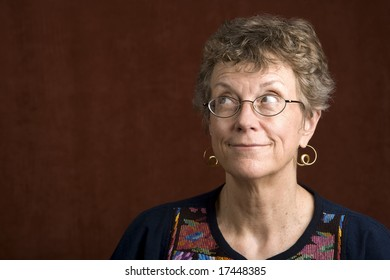 Senior woman looking with glasses looking up