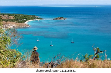 senior woman looking from spectacular view of Captain Cooks lookout from the top of Lizard Island over the Great Barrier Reef, Queensland, Australia