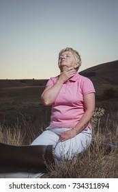 senior woman make a breath exercises at evening