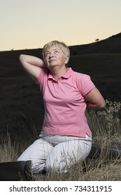 senior woman make a stretching exercises