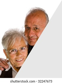 senior  woman  & man holding a blank over white background