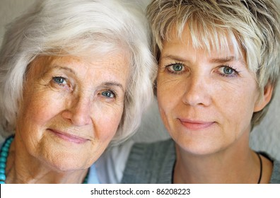 Senior woman and mature daughter portrait