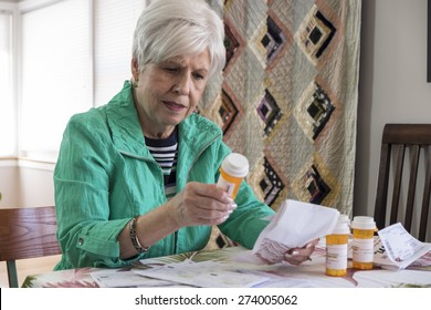 Senior woman with medication, reviewing instructions, side effects