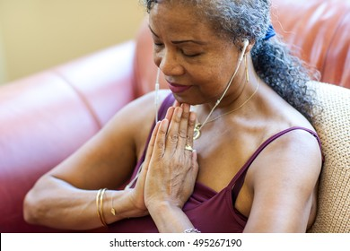 Senior Woman meditating at home