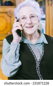 Senior woman with mobile at home