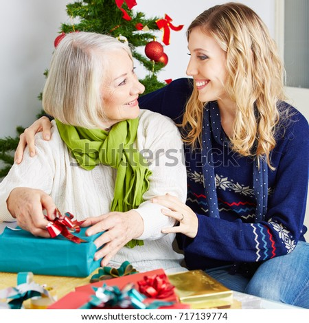 senior woman in nursing home with gifts at christmas