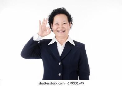 Senior woman ok hand sign on white background