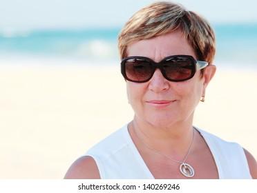 senior woman on summer vacation at sea