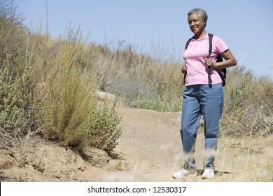 Senior woman on walk in countryside