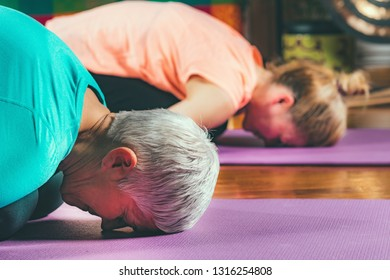 Senior woman on yoga private session