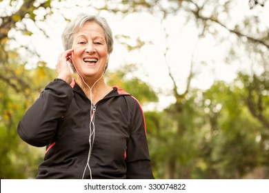 Senior woman in the park on an autumns day