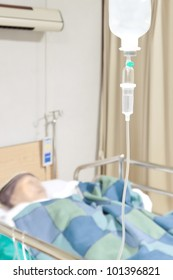 Senior woman patient in the hospital bed saline intravenous (iv) drip