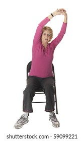 Senior woman performing arm stretch on chair. White background